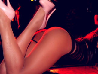 Stripper in g-string and heels on stage